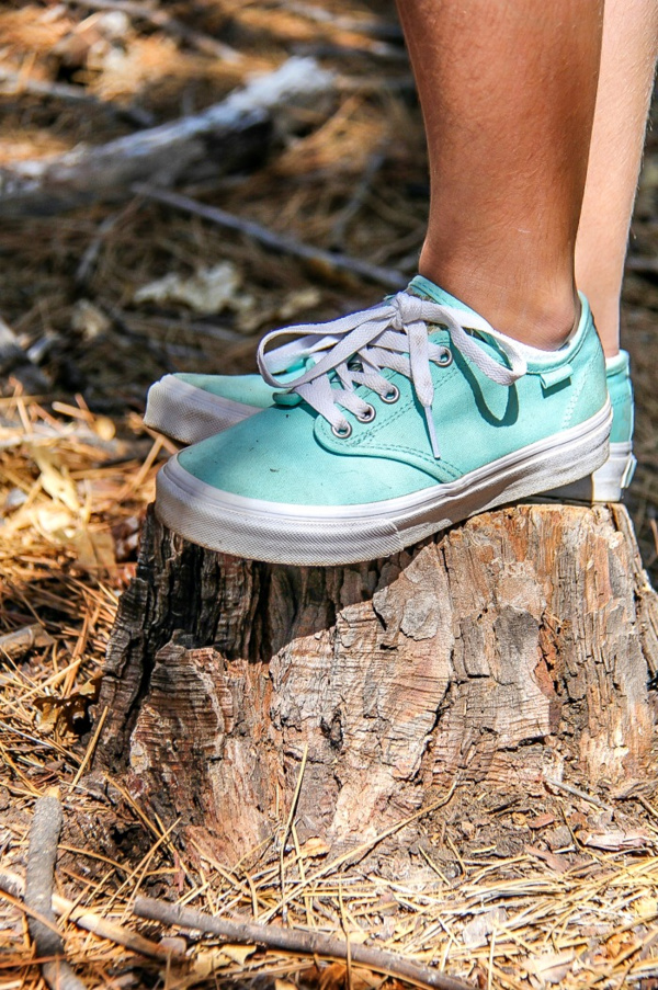 girl wearing aqua vans shoes