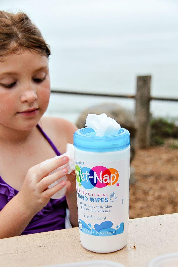 girl using Wet Nap antibacterial wipes