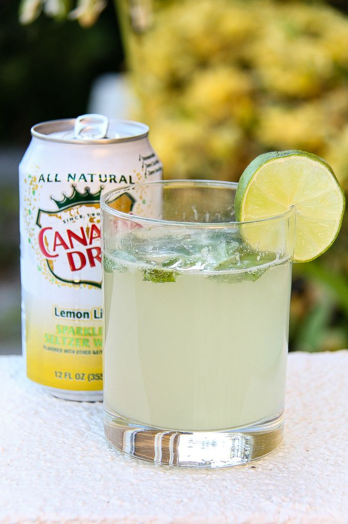 canada dry lemon lime with a cocktail garnished with a lime slice