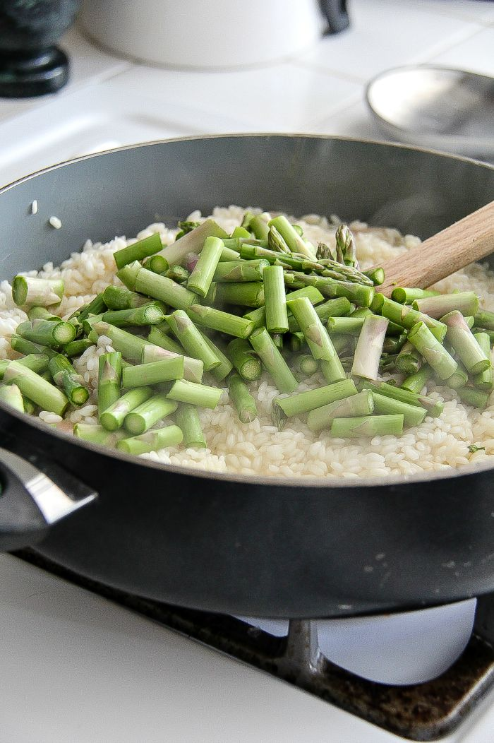 asparagus and rice in a pan to make risotto