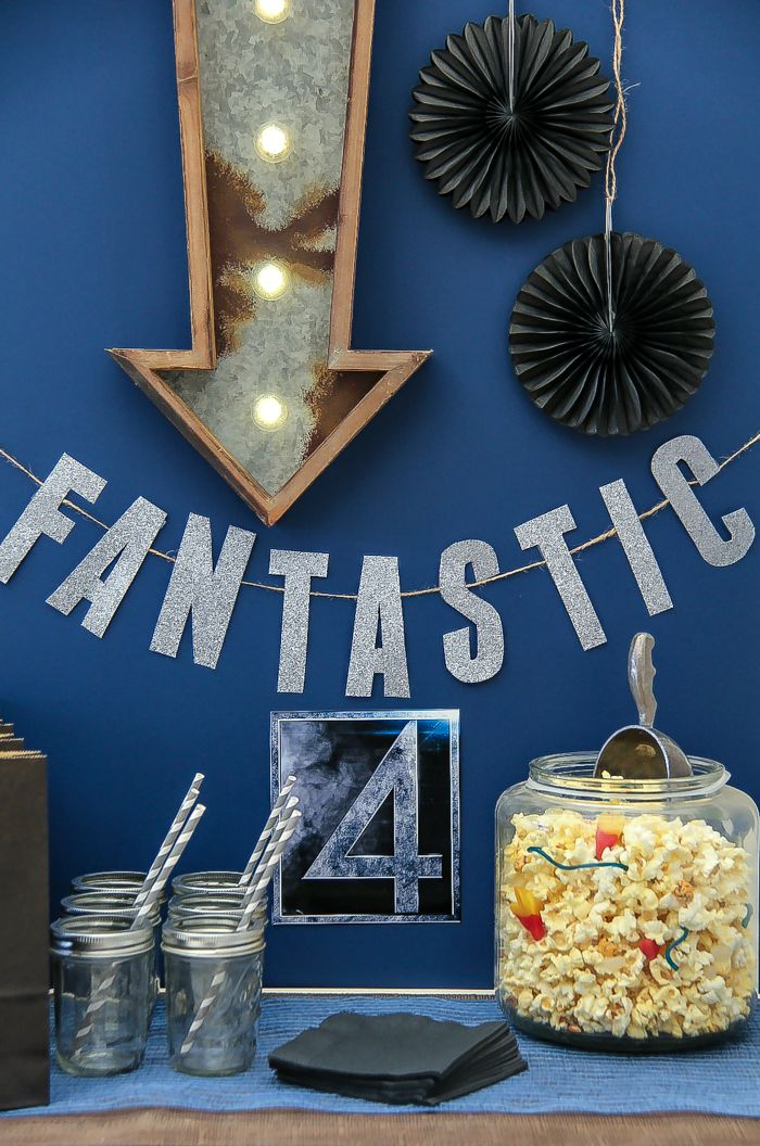 a fantastic 4 movie night table with popcorn and lighted signs