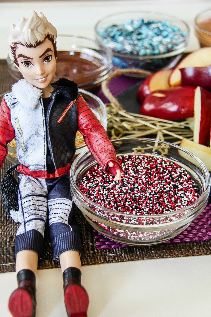 carlos descendants doll with red, black, and white sprinkles mix