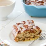 a slice of cinnamon roll casserole on a white plate