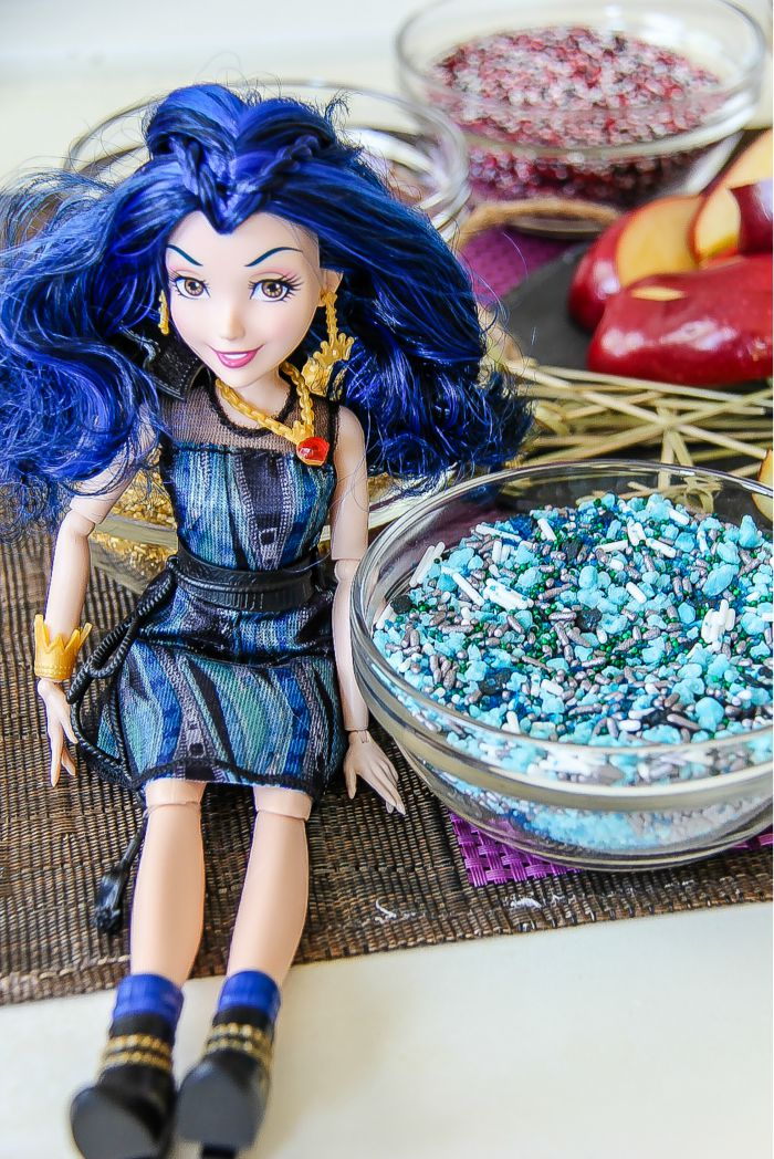 Evie Descendants doll with blue and white sprinkles for cake decorating