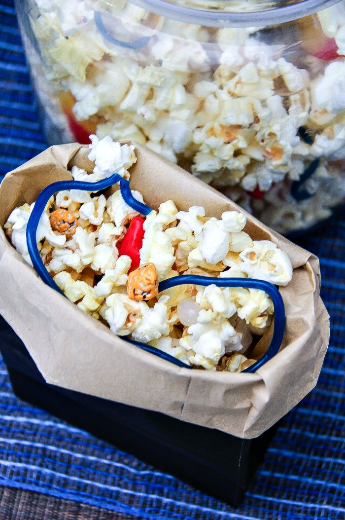 popcorn mix with candy in blue bags with the top rolled down inspired by the fantastic four