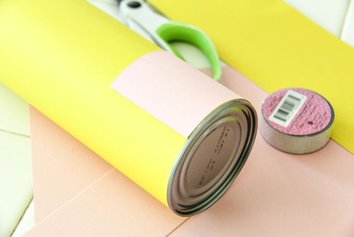 a canister covered in pink and yellow paper to make a pencil