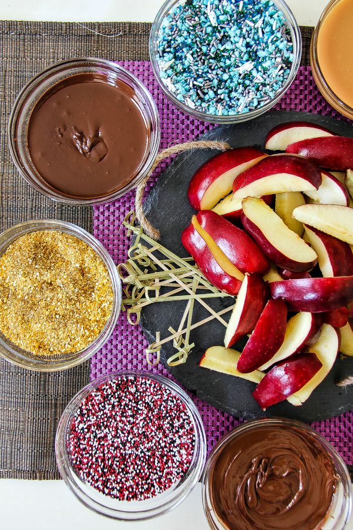 apple slices with chocolate and sprinkles
