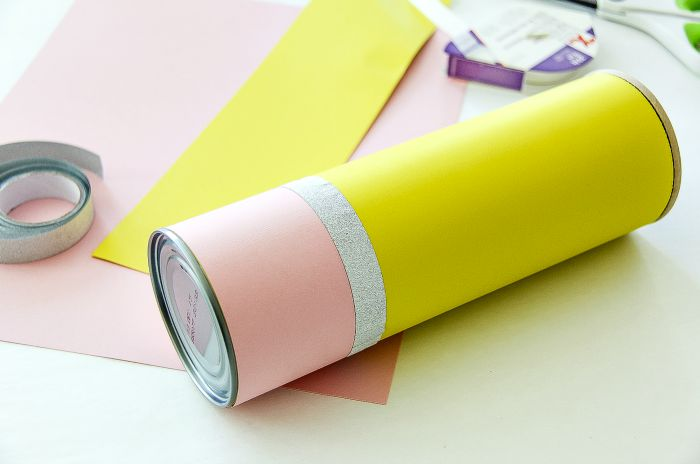 a pencil canister with craft supplies