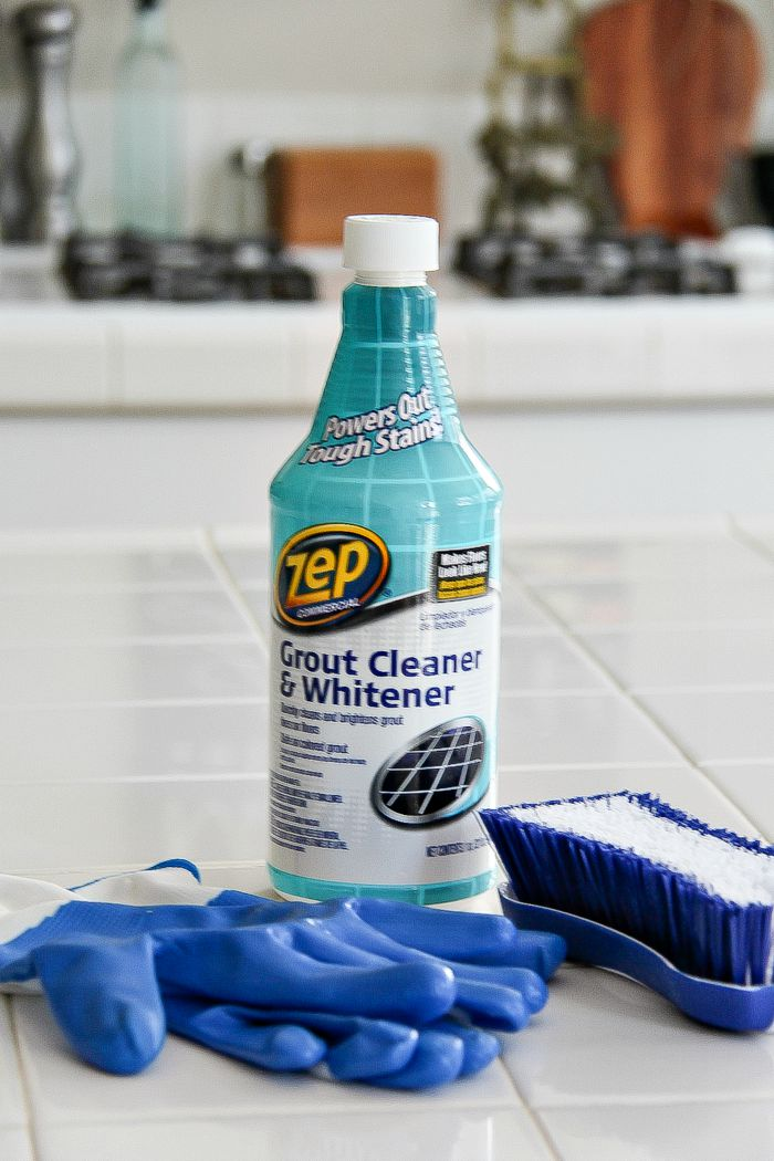 white kitchen with Zep grout cleaner, brush, and blue gloves
