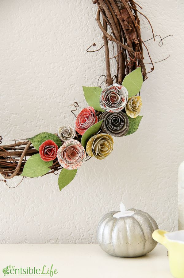 stick wreath with paper flowers in fall colors