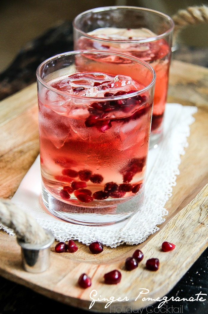 a pomegranate cocktail in a glass with real pomegranate