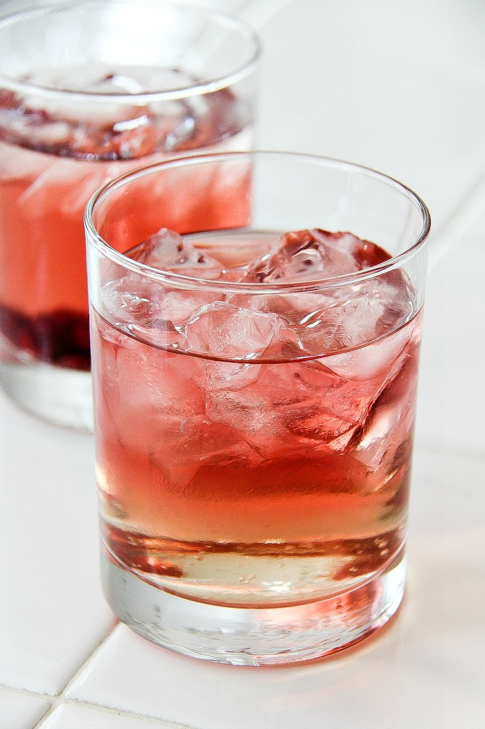 glass with rose, ginger ale, and ice