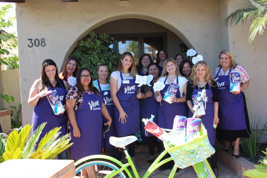 a group of women wearing purple viva paper towels aprons