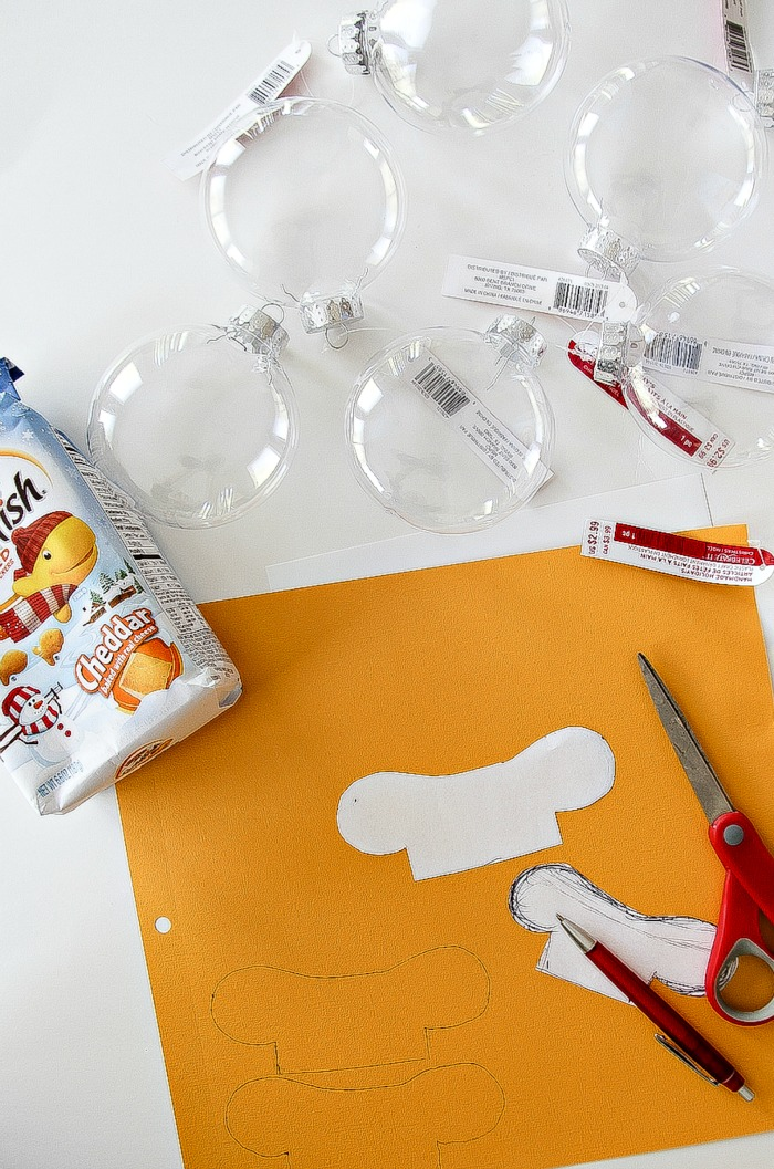 clear christmas ornaments, goldfish crackers, and yellow card stock