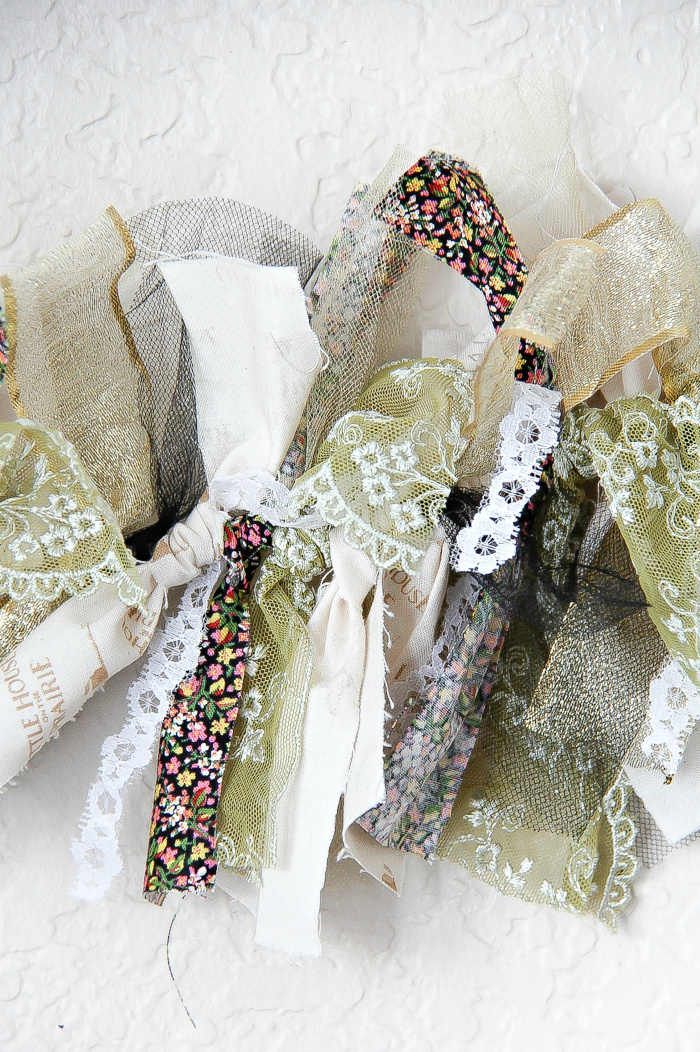 fabric and ribbon tied onto hemp cord