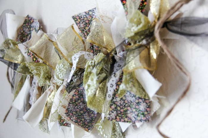 scrap fabric and ribbon garland in green, black, and gold