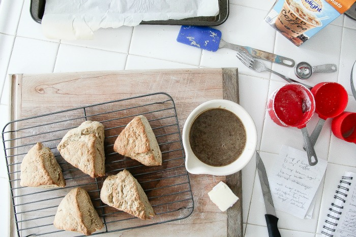 scones on a cooling rack with a jug of caramel sauce to pour over them
