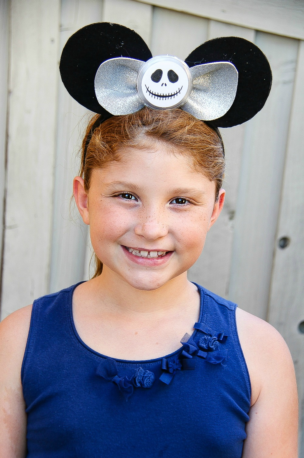 girl wearing a jack skellington mickey mouse ear headband