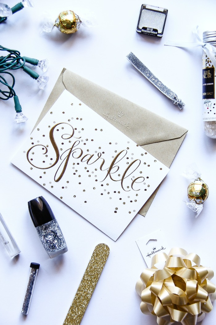 sparkle greeting card surrounded by stocking stuffer ideas