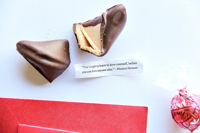 a chocolate coated fortune cookie with a message about loving yourself