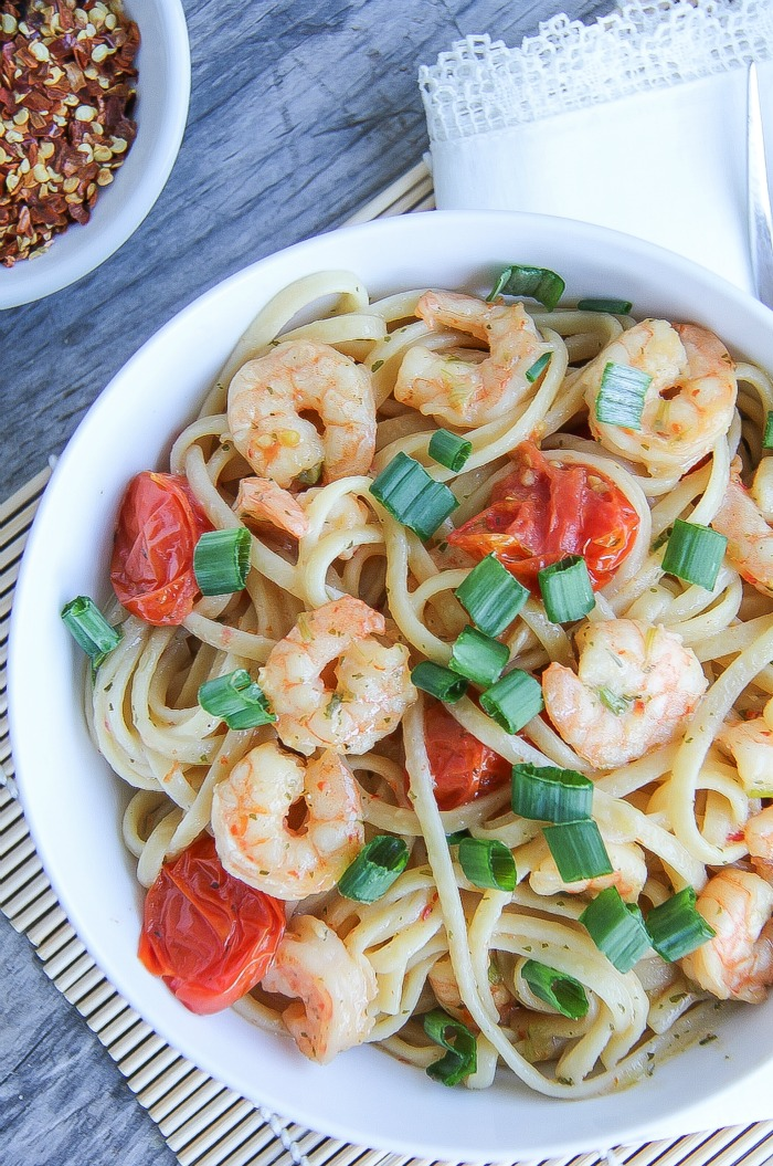 shrimp, pasta, and tomatoes in a bowl served for a meal