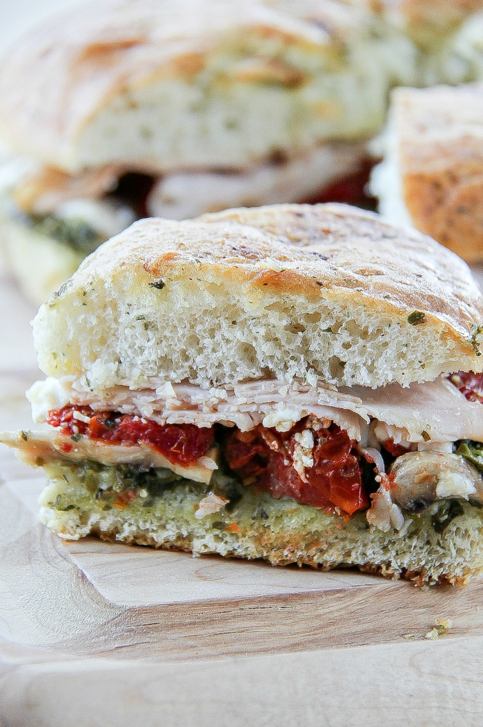 one serving of a turkey pesto sundried tomato focaccia sandwich