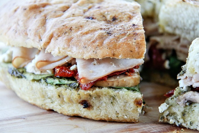 a turkey pesto focaccia sandwich that's been sliced