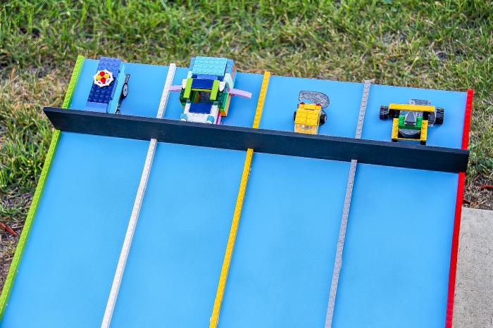 A handmade race track for racing LEGO cars.