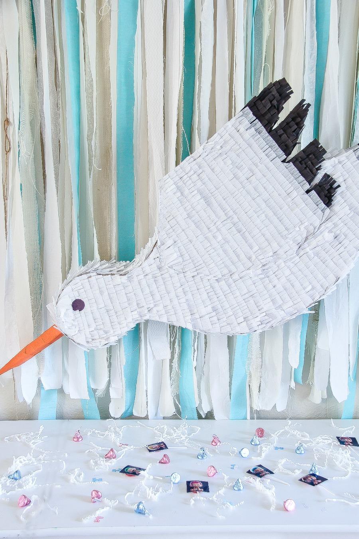 a handmade stork pinata