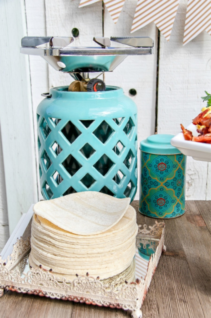 How to use a portable camp stove to heat tortillas outdoors for a taco bar
