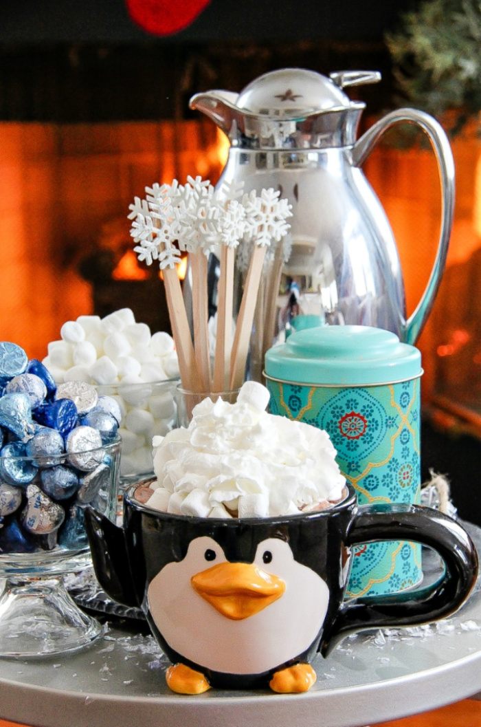 penguin mug filled with hot chocolate and marshmallows