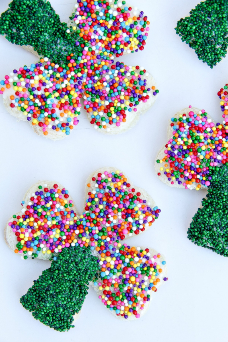Shamrock shaped fairy bread with green and rainbow sprinkles for St. Patrick's Day.