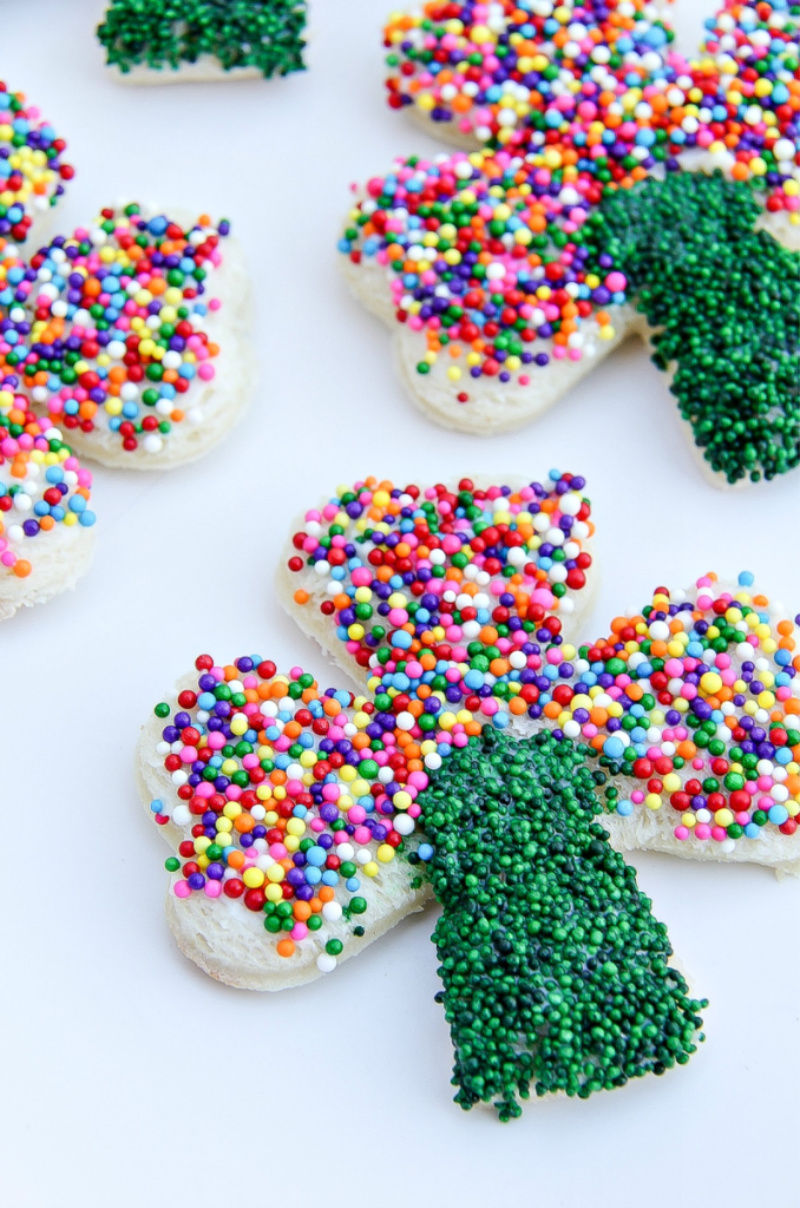 rainbow sprinkle shamrock shaped fairy bread treats for St. Patrick's Day.