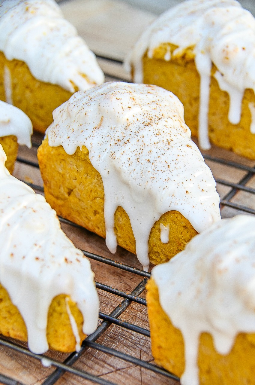 pumpkin scones covered in icing and cinnamon.
