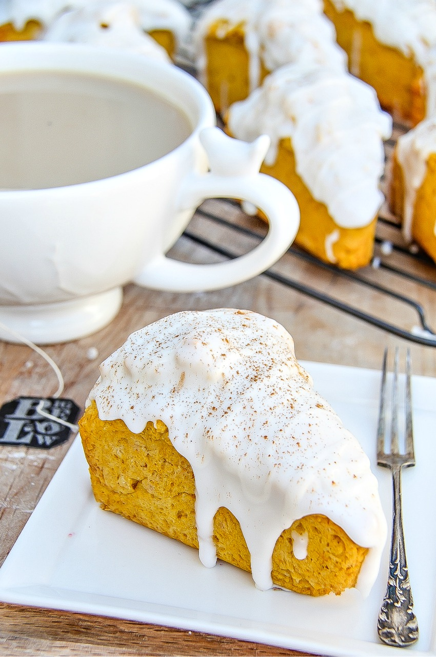 homemade pumpkin scones covered in icing.