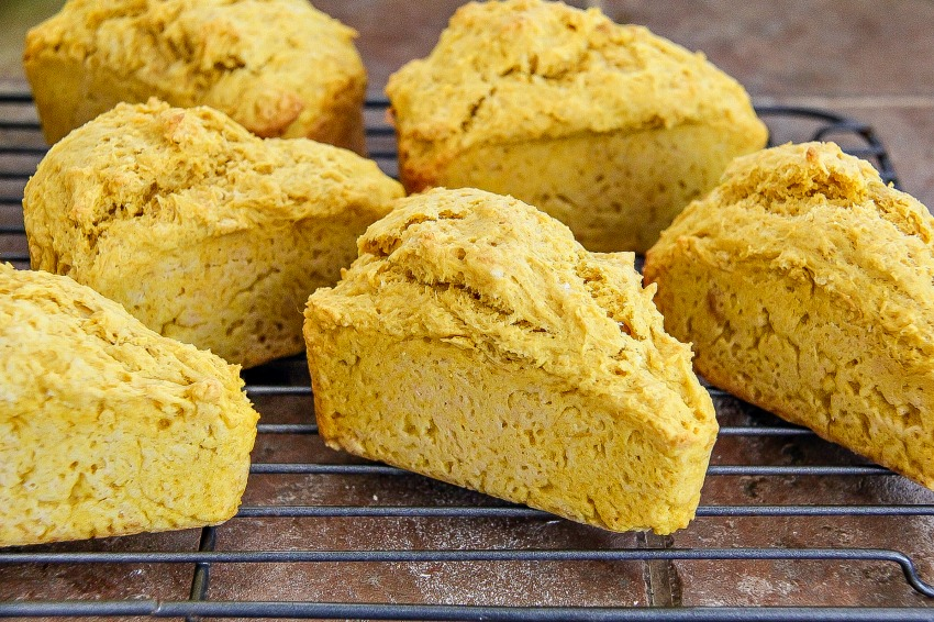 Pumpkin scones cooling on a wire rack.