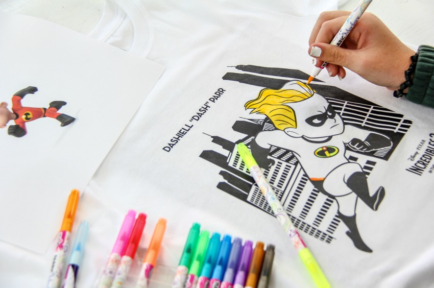 an Incredibles coloring page printed onto a tshirt for kids to color in