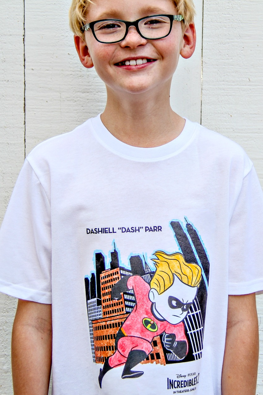 A boy wearing a Disney Incredibles t-shirt made from a coloring page that was colored in with fabric markers.