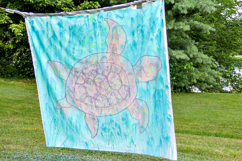 watercolor turtle painted on a canvas with squirt guns
