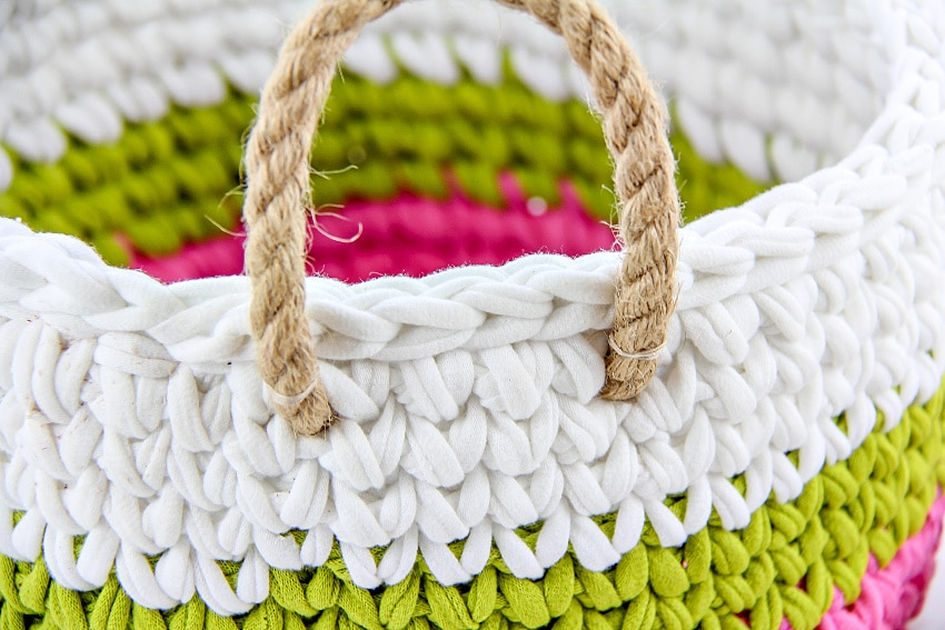 crochet basket in white, green, and pink with cord rope handles