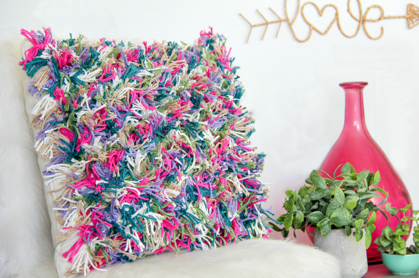 a colorful yarn cushion