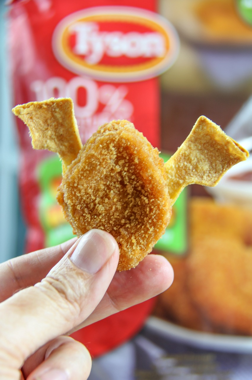 Chicken nugget bat Halloween party food with tortilla bat wings.
