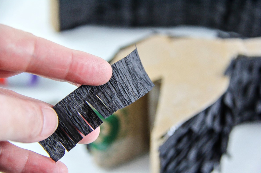 A tutorial for cutting and attaching crepe paper to a diy pull string pinata.
