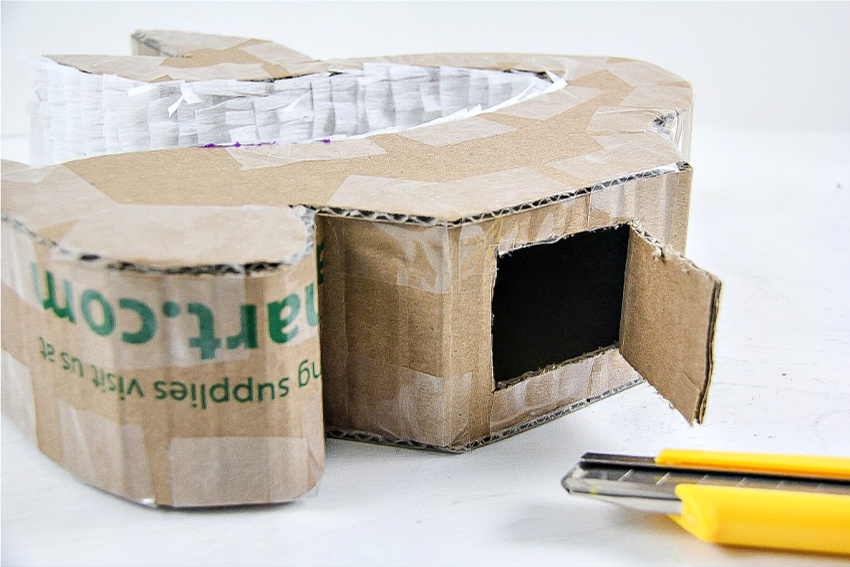 A step by step tutorial for how to make a pinata out of a cardboard box.