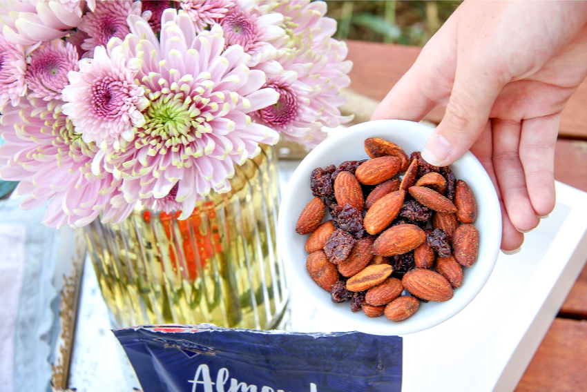 Blue Diamond Almonds & Fruit Fiery Ghost Pepper & Tart Cherry on a small tray for entertaining.