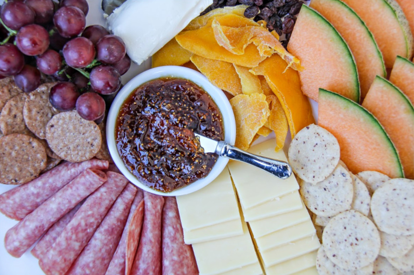 A gluten-free charcuterie board with gluten-free crackers.