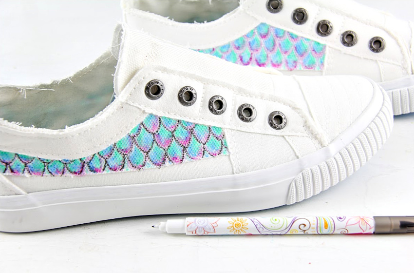 white canvas shoes hand painted to look like a mermaid