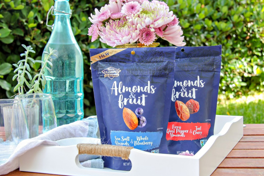 Blue Diamond almonds and fruit snacks on a serving tray.