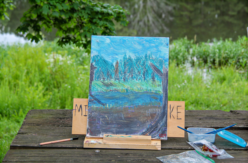 an outdoor painting done in a forest