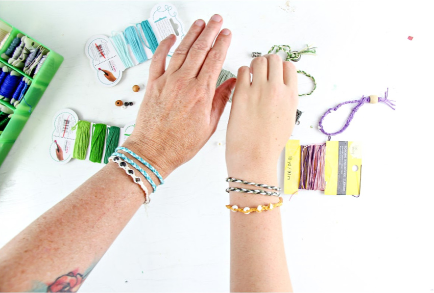 Handmade friendship bracelets made out of thread and beads.